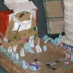 Created by Ella, Eleanor, Sarah, Bridget and Nikhila, It is a concert full of people. Made out of boxes and paper. The girls raise the curtains for performances daily at 4:00.