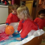 Mixing the paint and shaving cream.